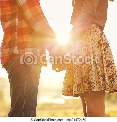 Young couple in love walking in the autumn park holding hands lo - csp21472489