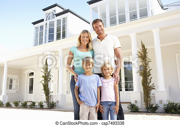 Young Family Standing Outside Dream Home - csp7493338
